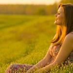 Beautiful girl watching sunset — Stock Photo #24333003