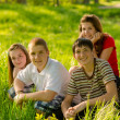 Teenage friends having fun  in the park on sunny spring day - Stock Photo
