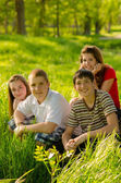 Teenage friends having fun in the park on sunny spring day — Stockfoto