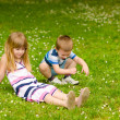 Brother and sister on the meadow — Stock Photo