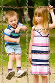 Brother and sister playing on the playground — Stockfoto