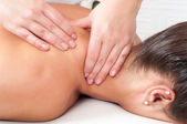 Young woman getting massage in massage salon — ストック写真