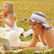 Mother and daughter having fun in the nature on sunny summer day — Stock Photo