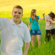 Teenage boy with his friends in the nature — Stock Photo