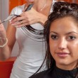 Hairdresser making hair — Stock Photo