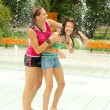Having fun in the water fountain — Stock Photo