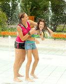Having fun in the water fountain — Stock Photo