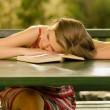 Cute girl sleeping on the table — Stock Photo