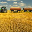 Tractor with trailers on the agricultural field — Stock Photo