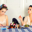 Young housewives having fun with cosmetics — Stock Photo