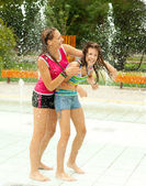 Having fun in the water fountain — Foto de Stock