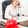 Female architect working in the office — Stock Photo