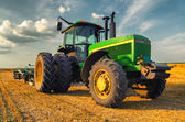 Tractor on the agricultural field — Stock Photo