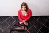 Female prostitute sitting on the floor — Stock Photo