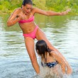 Teenage girls having fun in the river — Stock Photo #29073313