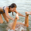 Teenage girls playing in the water — Stock Photo