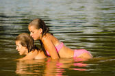Teenage girls lying in the river — Stock Photo