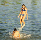 Teenage girl jumping into the river — Stock Photo