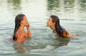Teenage girls having fun in the sea — Stock Photo