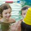 Father and his children playing in the swimming pool — Stock Photo