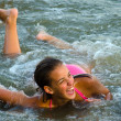 图库照片: Beautiful teenage girl having fun in the sea