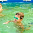 Children playing in the swimming pool — Stock Photo