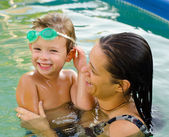 Mother and son in the swimming pool — Stock Photo