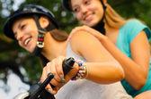 Teenage girls riding motorcycle — Stock Photo