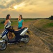 Teenage girls resting after riding motorcycle — Stock Photo #30350523