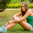 Teenage girl sitting in the park — Stock Photo