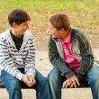 Two teenage friends talking in the park — Stock Photo