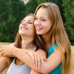 Two beautiful girls having fun outdoor — Stock Photo #30748433