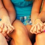 Teenage girls holding hands — Stock Photo