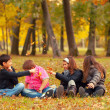 Teenagers playing in park in autumn — Stock Photo