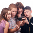 Teenage boy showing digital content to friends — Stock Photo