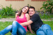 Young couple having fun in the garden — Stock Photo