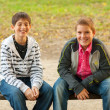 Two teenage friends having fun in the park — Stok fotoğraf