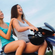 Two beautiful girls riding motorcycle — Stock Photo