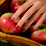Female hand picking apple — Stock Photo