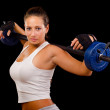 Beautiful young woman exercising with weights — Stock Photo