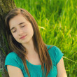 Teenage girl sleeping in the nature — Stock Photo