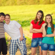 Four teenage friends in the nature — Stock Photo