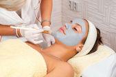 Young woman with natural facial mask — Stock Photo