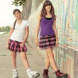 Teenage girls on roller skates having fun — Stock Photo