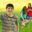 Teenage boy having fun with his friends — Stock Photo