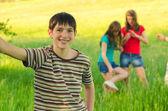 Teenage boy having fun with his friends — Stock Photo