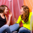 Two teenage girls having fun on the bed — Stock Photo