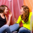 Two teenage girls having fun on the bed — Stock Photo #32773511