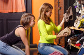 Teenage girls choosing clothes — Stock Photo