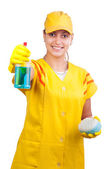 Beautiful young cleaning lady — Stock Photo